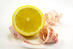 Lemon and ruler. On a white background Stock Photography