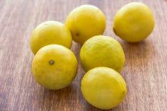 Lemon. Scattered lemons on a wooden base Stock Image
