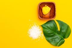 Lemon scrub on a yellow background. Organic skin care royalty free stock photos