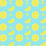 Lemon seamless pattern with half and slice stock image