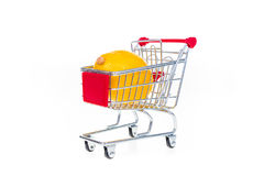 Lemon in shopping cart isolated on white background Stock Photography