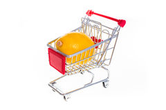 Lemon in shopping cart isolated on white background Royalty Free Stock Images