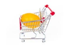 Lemon in shopping cart isolated on white background. Concept photo Royalty Free Stock Image