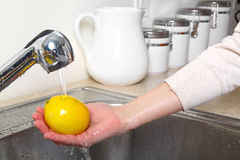 Lemon in the sink Royalty Free Stock Photos
