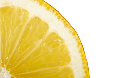 Lemon slice. Close-up of a lemon slice on white background royalty free stock photos