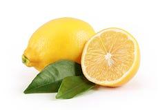Lemon with slice Royalty Free Stock Image