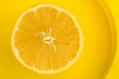 Lemon slice. On yellow plate Stock Images