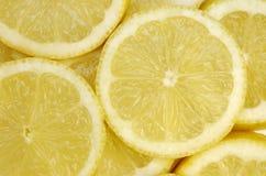 Lemon slice background. Slices of yellow fresh lemon (background Royalty Free Stock Photography