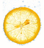 Lemon slice in clear water. Close-up of lemon slice in clear water with bubbles stock photos