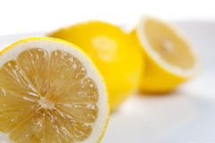 Lemon slice close up. Lemon sliced into two with one close up shot Stock Images