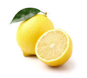 Lemon with slice. In closeup Royalty Free Stock Photos