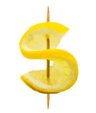 Lemon slice in the form of a dollar sign on a toothpick isolated on white. Background stock photo