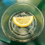 Lemon slice in the glass Royalty Free Stock Images
