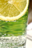 Lemon slice. Slice of lemon in glass with water bubbles Royalty Free Stock Photo