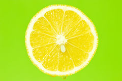 Lemon slice on green background Stock Photo
