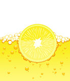 Lemon slice in the juice Stock Photography