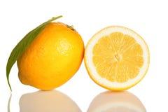 Lemon and slice of lemon  on white. Lemon and slice of lemon with a leave  on white Royalty Free Stock Photo