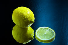 Lemon and slice reflection. On a mirror Royalty Free Stock Images