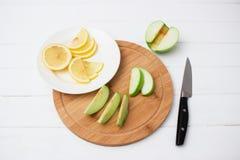 lemon slice ripe apple round board. Stock Images