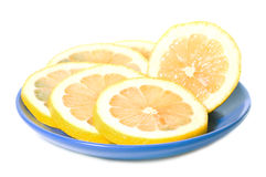 Lemon slice  in saucer Royalty Free Stock Photography