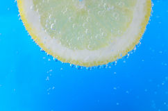 Lemon Slice in Sparkling Water Stock Photo
