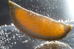 Lemon slice under water with bubbles Royalty Free Stock Image