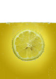 Lemon slice in water Royalty Free Stock Photos