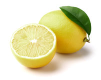 Lemon with slice. On a white background stock images