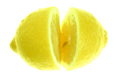 Lemon, sliced. Lemon sliced in half isolated on white royalty free stock images