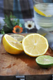 Lemon sliced on cutting board Stock Photography