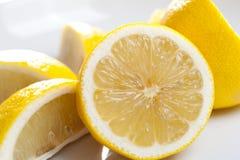 Lemon sliced different ways. Lemon sliced in half and quarter cuts Stock Photo