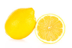 Lemon. With a sliced part, isolated on a white background Stock Image