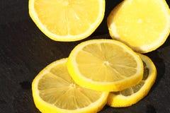 Lemon sliced slate. Royalty Free Stock Photos