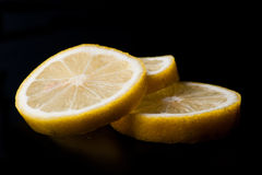 Three lemon slices Stock Images