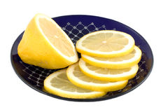 Lemon slices. Sliced lemon on a plate Royalty Free Stock Image