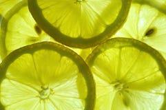 Lemon slices. Fresh yellow lemon slices background Royalty Free Stock Photography