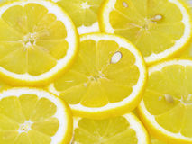 Lemon slices background, bright yellow Stock Photo
