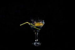 Lemon slices dropped in a glass with a cocktail Stock Image