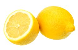 Lemon with slices isolated on white background. healthy food stock photos