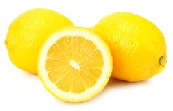 Lemon with slices isolated on white background. healthy food royalty free stock photo
