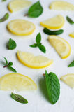 Lemon slices with mint leaves on white background Royalty Free Stock Photo