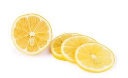 Lemon slices over white background Stock Photos
