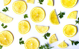 Lemon slices and  parsley leafs on white Stock Image