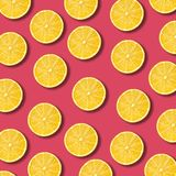 Lemon slices pattern on vibrant pomegranate color background. Minimal flat lay food texture royalty free stock photography