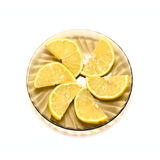 Lemon slices on plate Stock Photo