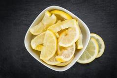 Lemon Slices on a vintage slate slab selective focus. Some fresh Lemon Slices on a vintage slate slab selective focus; close-up shot Stock Photography