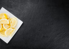 Lemon Slices on a vintage slate slab selective focus Royalty Free Stock Photos