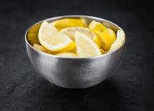 Lemon Slices on a vintage slate slab selective focus. Some fresh Lemon Slices on a vintage slate slab selective focus; close-up shot Royalty Free Stock Images
