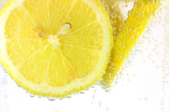 Lemon slices in water. Sliced lemon in refreshing fizzy water royalty free stock photos