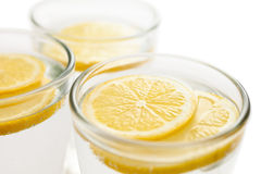 Lemon slices in water Royalty Free Stock Photography
